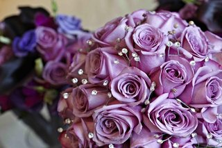 wedding-bouquet-with-purple-roses-and-dotted-crystals