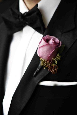 groom-wearing-lavender-pink-rose-on-tuxedo-lapel