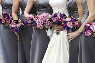 bride-with-bridesmaids-holding-purple-bouquets