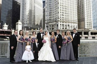 bride-and-groom-with-wedding-party-in-front-of-skyline