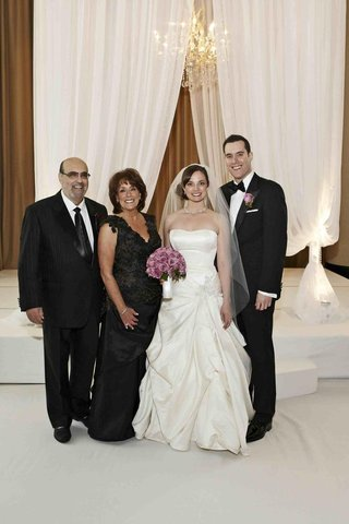 black-mother-of-bride-dress-and-fathers-pinstripe-suit