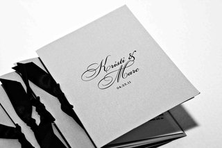 black-and-white-photo-of-wedding-program-with-ribbon