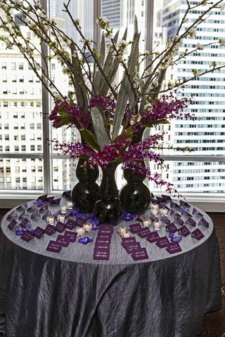 purple-escort-card-display-in-front-of-skyline-view
