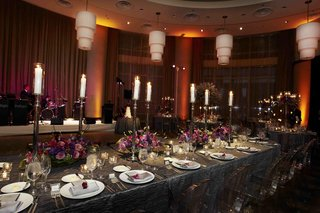 grey-linens-at-wedding-reception-with-purple-flowers