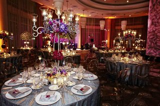 silver-table-linens-with-clear-oval-back-chairs-at-wedding-reception