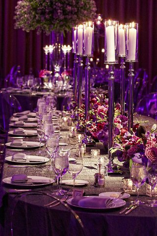 tall-candlesticks-on-wedding-table-with-purple-orchid-and-rose-flowers