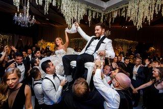 wedding-reception-hora-dance-jewish-wedding-traditions-reception-reem-acra-wedding-dress-groom-white