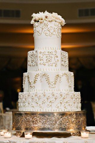 white-wedding-cake-round-hexagon-layers-flowers-vines-and-flowers-on-top