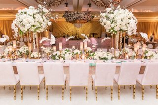 wedding reception ballroom ceiling installation chandelier over dance floor long head table gold