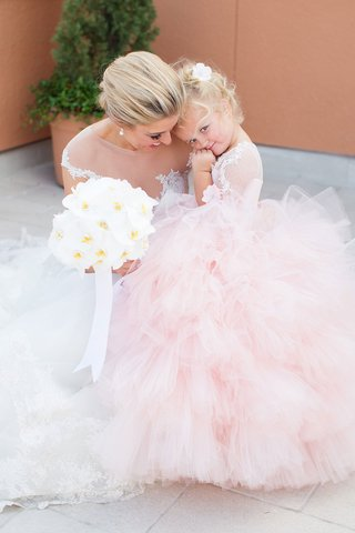 bride-with-orchid-bouquet-and-flower-girl-in-pink-ball-gown-tulle-ruffle-layer-skirt