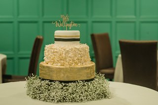 three-tier-wedding-cake-gold-layer-stripe-layer-ruffled-layer-base-on-babys-breath