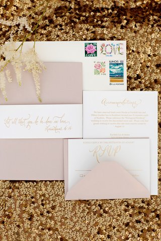 wedding-invitation-suite-in-pink-and-gold-with-custom-stamps