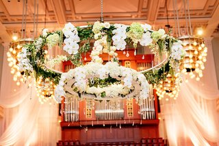 two-tiered-floral-chandelier-with-orchids-hydrangeas-and-greenery