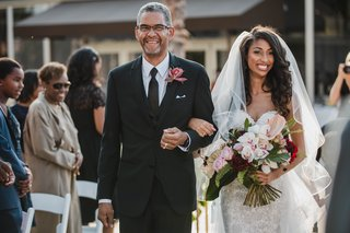 bride-in-eve-of-milady-wedding-dress-walking-down-the-aisle-with-her-father