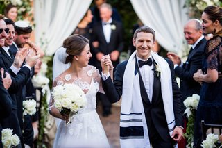bride-and-groom-jewish-wedding-recessional-sheer-blouse-flower-lace-over-monique-lhuillier-dress
