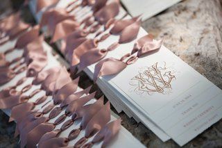 delicate-white-programs-with-gold-calligraphy-and-pink-bows