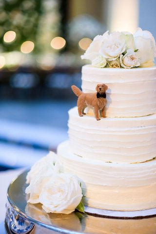 wedding-cake-three-layer-white-with-fresh-flower-cake-topper-and-figurine-of-golden-retriever