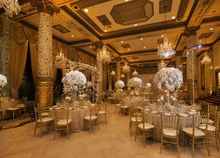 wedding-reception-in-the-drake-hotel-gold-coast-room-with-tall-floral-centerpieces
