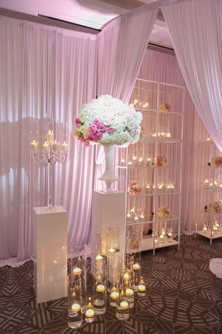 white-shelves-with-floating-candles-candelabra-white-and-pink-flowers