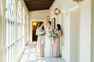 bride-and-two-bridesmaids-in-tan-off-shoulder-dresses-lace-wedding-dress-ivory-bouquets