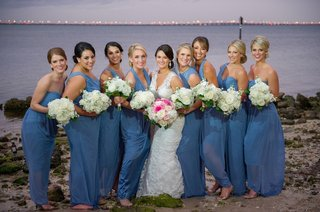 bride-with-bridesmaids-barefoot-in-the-sand