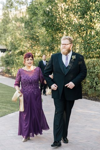 mother-of-groom-in-purple-gown-embroidered-bodice-three-quarter-sleeves-sash-necklace