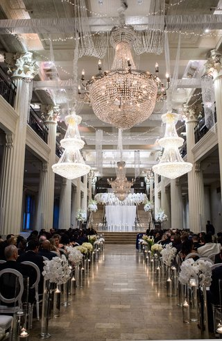 wedding-ceremony-corinthian-ballroom-houston-floating-candles-white-flowers-chandeliers-orchid-halo