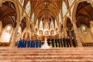 bride-in-vera-wang-groom-in-vera-wang-bridesmaids-in-cobalt-blue-bill-levkoff-holy-name-cathedral