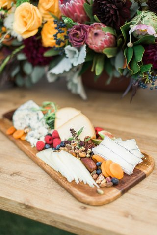 wooden-board-fruits-nuts-cheeses-california-winter-wedding-styled-shoot-rustic-boho-ranch-outdoors