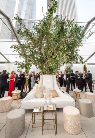 indoor-tree-tent-wedding-cocktail-hour-reception-tree-like-arrangement-neutral-pillows-ottomans