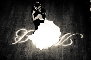 black-and-white-photo-of-bride-in-a-maggie-sottero-dress-dancing-with-groom
