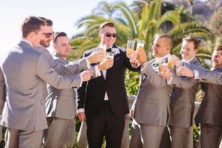 groom-in-ermenegildo-zegna-groomsmen-in-tommy-hilfiger-toast-to-each-other