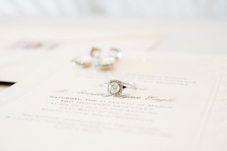 round-diamond-engagement-ring-in-halo-setting-with-polished-band-on-invite