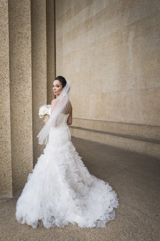bride-in-a-strapless-mark-zunino-dress-with-buttons-down-back