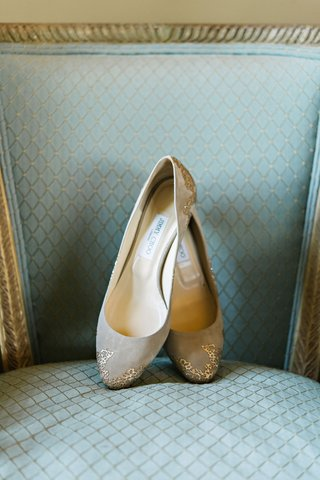 jimmy-choo-nude-flats-bridal-wedding-shoes-with-gold-details-on-toe-and-heel