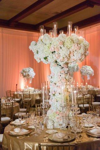 flower-sculpture-centerpiece-with-candelabra-details-gold-linens-tall-flower-arrangement
