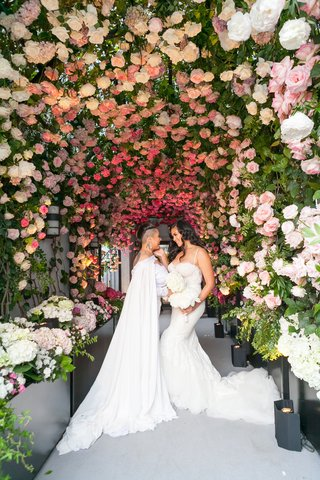 brides-same-sex-wedding-gay-ceremony-under-tunnel-of-roses-and-greenery-at-rooftop-venue