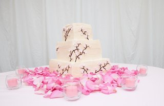 wedding-cake-on-pink-rose-petals-with-cherry-blossom-design