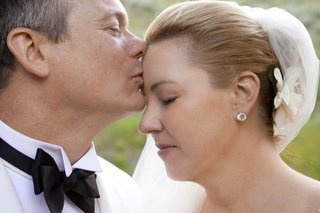 groom-kisses-brides-forehead-on-wedding-day