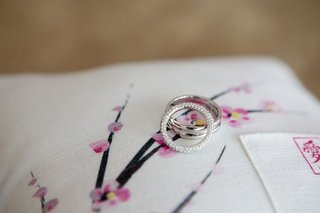 wedding-rings-on-cherry-blossom-print-pillow