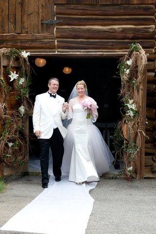 bride-and-groom-exit-ceremony-at-ranch-venue