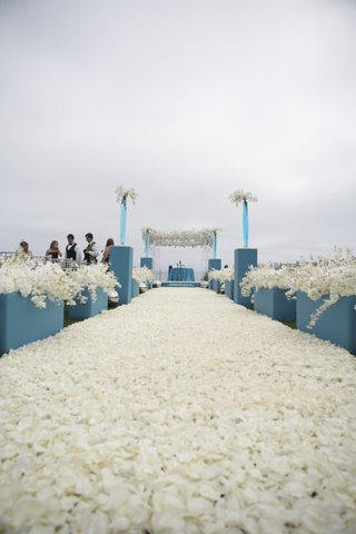 aisle-covered-with-carpet-of-white-flower-petals