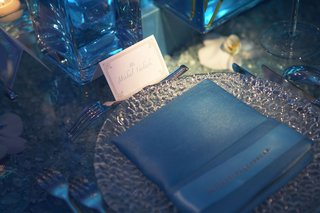 place-setting-with-silver-charger-and-blue-napkin