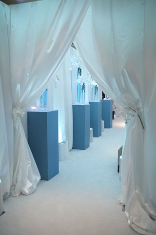 white-curtains-leading-to-blue-and-white-reception