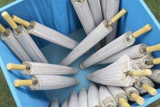 white-umbrellas-in-blue-box