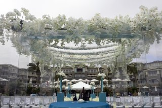 lucite-chuppah-topped-with-white-orchids-and-paper-cranes