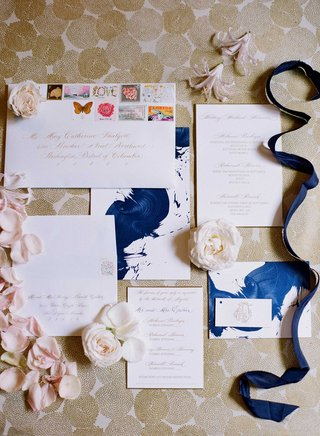 storkie-express-wedding-invitation-suite-with-blue-paint-brush-stroke-design-and-stamps