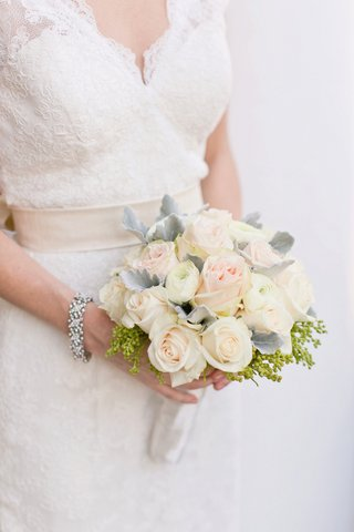 bride-in-a-lace-watters-dress-with-bouquet-of-white-ranunculus-light-pink-roses-dusty-miller