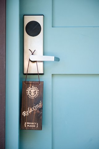 wood-door-sign-that-asks-for-privacy-at-the-grooms-suite-at-the-ranch-at-laguna-beach