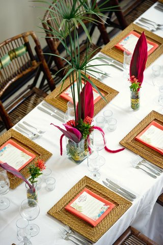 rattan-charger-with-palm-frond-centerpieces